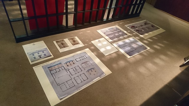 Installation of mounted drawings in progress at 'A Visual Window to an Ecclesiastical World' – an exhibition of Church of Ireland architectural drawings at the Irish Architectural Archive, Dublin.