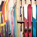 Ski shop sale. Rows of  colourful skis on wooden wall., foto: ski-blog.com