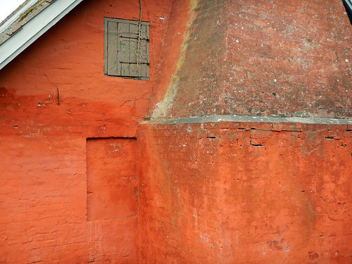 The orange wall of the local blacksmith building in Nordenbro, Denmark