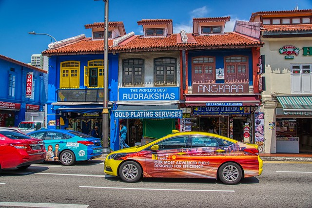Colorful shop houses and taxis in Little India in Singapore
