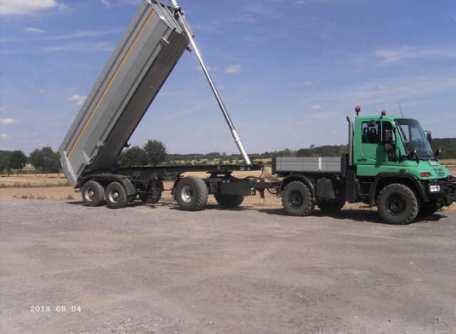 Unimog 405 with dolly and dump trailer