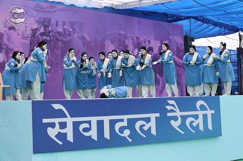 A musical item by ladies Sewa Dal volunteers