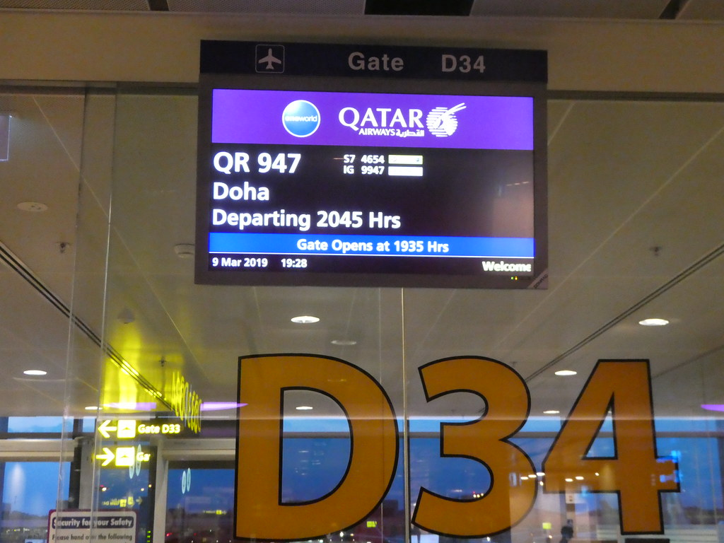 Waiting at the gate for our Qatar Airways flight from Singapore to Doha