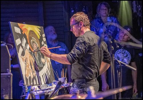 John Bukaty paints Jon Cleary during Piano Night - April 29, 2019. Photo by Marc PoKempner.