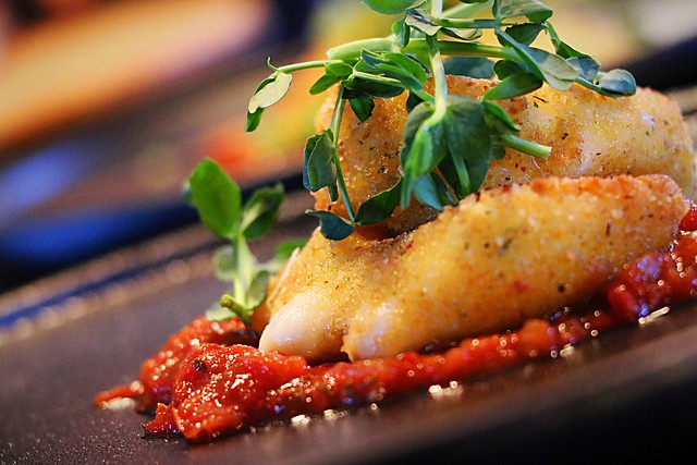 Fried cheese with confit tomatoes.