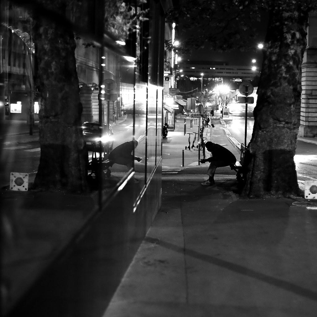 On the sidewalk bench