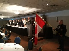 Lion Jim McGlade carries in the Canadian flag to start the District A4 Lions Convention held in Cornwall