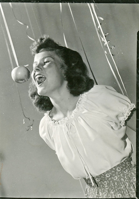 Young Woman Bobbing for Apple, 1940s