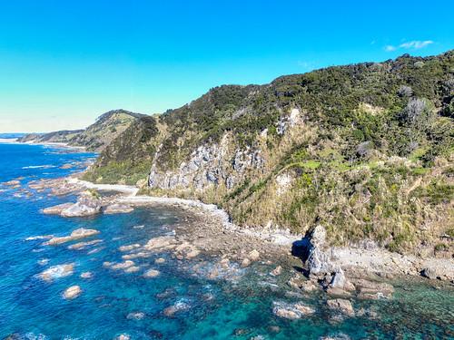 newzealand northlandregion north island treyratcliff stuckincustoms stuckincustomscom beack beach cliff rock ocean sea blue water hdr hdrtutorial hdrphotography hdrphoto aurorahdr foliage travel te arai