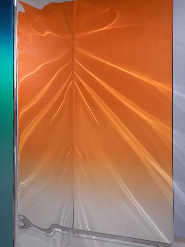 Rippling orange mylar mirror in the Rosenquist exhibit in the ARoS Museum of Modern Art in Aarhus, Denmark