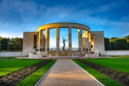 """Backside view of the """"Wall of the Missing"""" with 1,557 engraved names of the service members declared missing in action in Normandy.  The Statue is named """"Spirit of American Youth Rising from the Waves"""", Normandy American Cemetery and Memorial, France-34"""