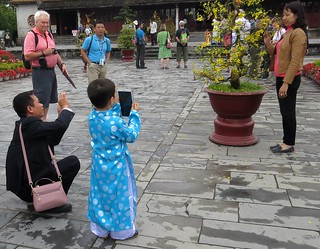A photographer starting young... outside a temple, Huế, Vietnam, Feb 2018