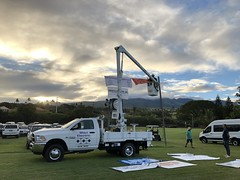 Maui Electric's 2019 Keiki Tilapia Fishing Tournament — May 11, 2019: One of our Maui Electric volunteers put up the sponsor banners before the tournament.
