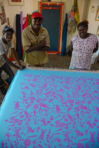 Featured artist Gabriella Maralngurra and printers Theo Gulamuwu and Sprotin Bangarr of Injalak Arts. Image courtesy of Injalak Arts and Crafts.