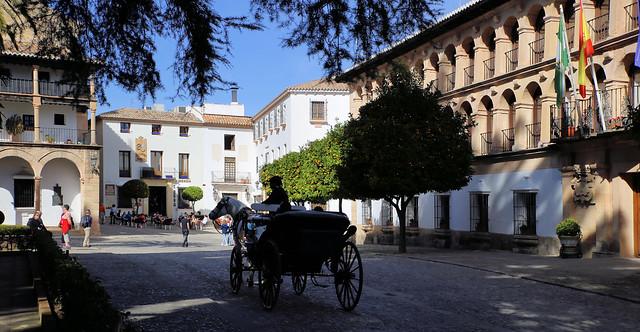 Horse carriage through the historical town Ronda