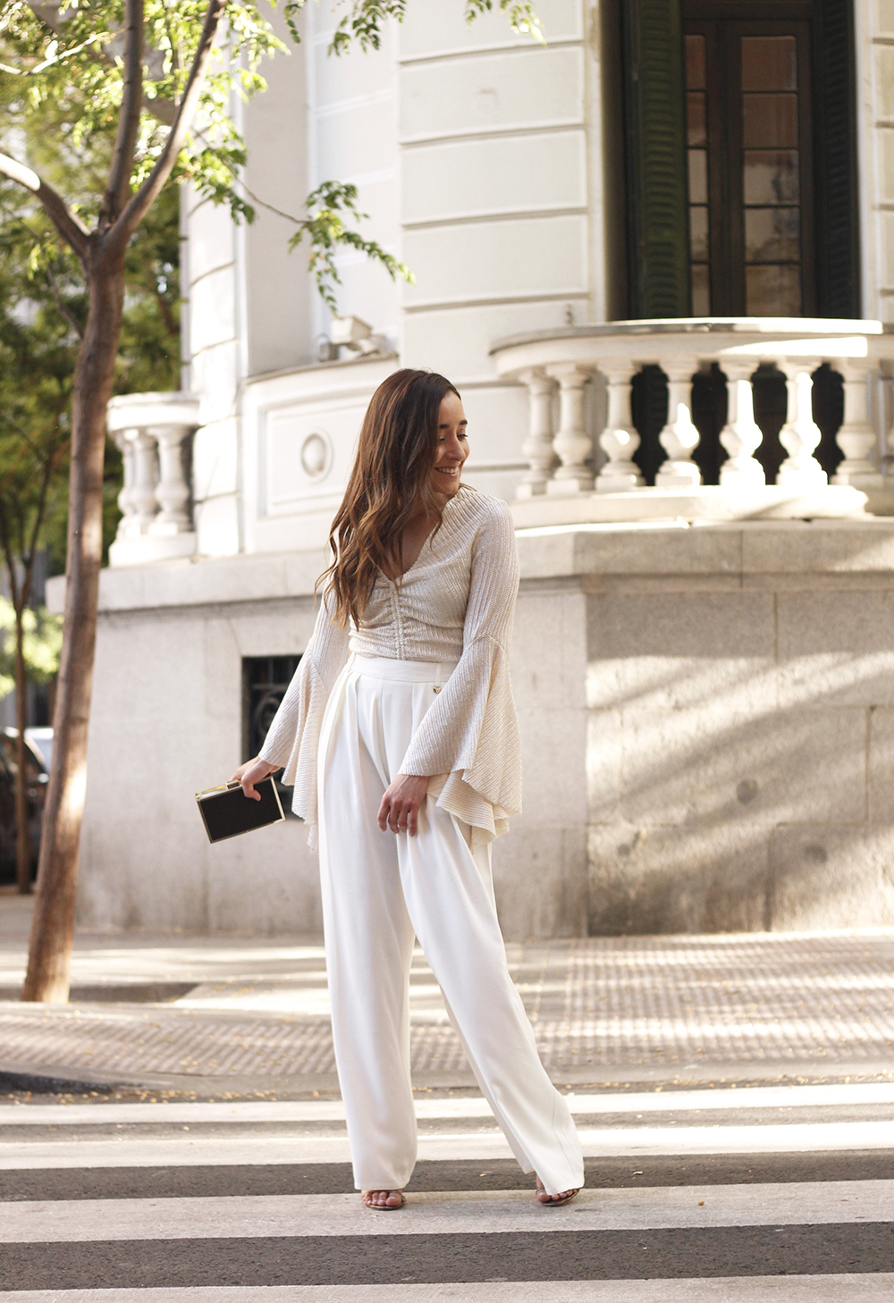 look de invitada lola casademunt white palazzo pants golden top street style outfit 20195