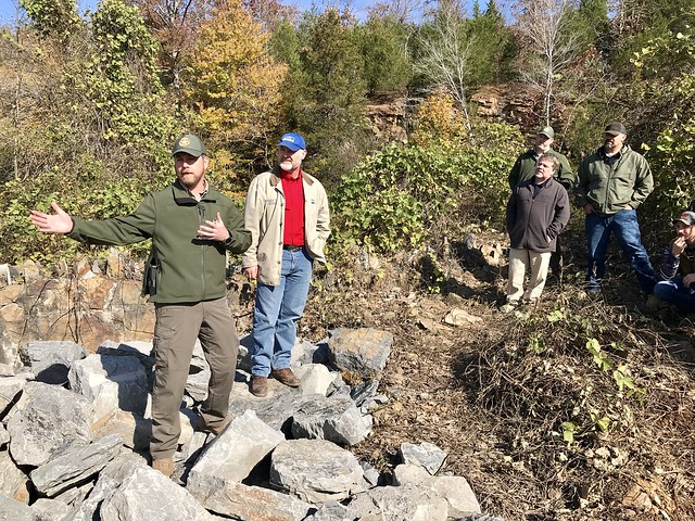Matthew Woodard, Woolly Hollow State Park Superintendent, and Walter Delp atop Lake Bennett Dam