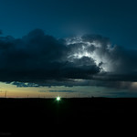 5. Juuni 2018 - 22:37 - A high based thunderstorm over the plains of North Dakota is illuminated by lightning during the twilight hour