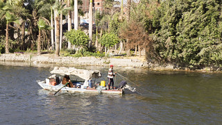 An Egyptian Fisherman and a wife fishing in the Nile   by Kodak Agfa