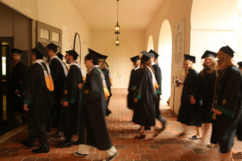 Students walk through the Wren Building on their way to Zable Stadium for the 2019 Commencement cermony.