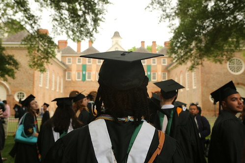 Graduates gather at the Wren Building before the traditional walk across campus.