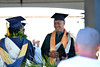 """A graduate at the Hawaii Community College–Palamanui commencement receives his diploma. Hawaii CC Palamanui celebrated spring 2019 commencement on Saturday, May 11, 2019 at the Palamanui campus. Go the Hawaii Community College's Flickr album for more photos from the Palamanui ceremony: <a href=""""https://www.flickr.com/photos/53092216@N07/sets/72157680393778068"""">www.flickr.com/photos/53092216@N07/sets/72157680393778068</a>"""