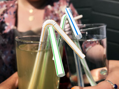 Stock photo image of a single use plastic straw being used in a drink.