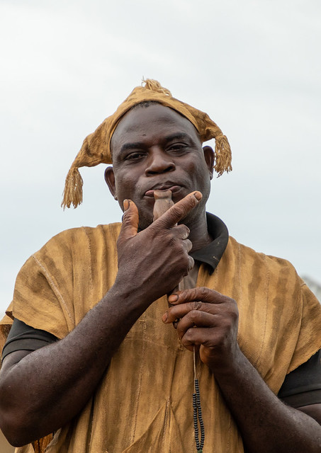 Senufo man using a flute during the Ngoro dance, Savanes district, Ndara, Ivory Coast