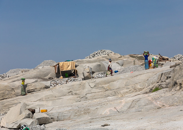 African people working in a granite quarry, Savanes district, Shienlow, Ivory Coast
