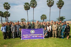 Attendees of a Pacific Partnership humanitarian assistance and disaster relief conference in Sattahip pause for a group photo, May 20. (U.S. Navy/MC2 Nicholas Burgains)