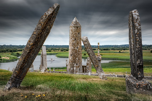 clonmacnoise countyoffaly ireland monastery medieval shannon graves gravestone tower mccarthystower finghin landscape architecture outdoor cool windy blur clouds gray green