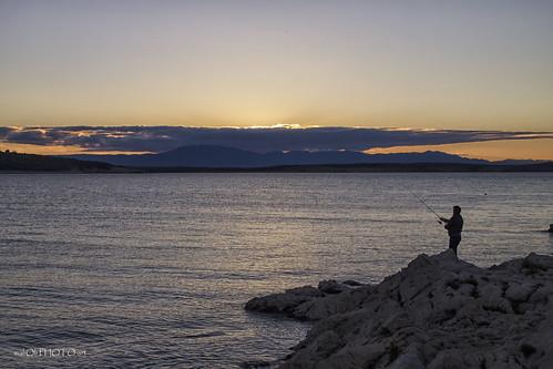 fishing fisherman coast adriatic jadran krk croatia hrvatska europe dusk sunset sundown
