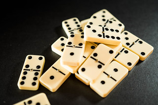 Dominoes pieces on a balck surface | by wuestenigel