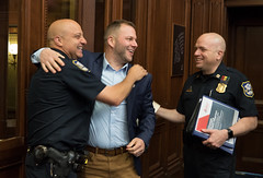 Rep. Joe Polletta greets his friends, Waterbury Police Officer Mike Digiovancarlo and Capt. Dan Lauer, after running into them during a session day in the House of Representatives.