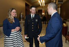 State Reps. Stephanie Cummings and J.P. Sredzinski talk with Waterbury Police Officer of the Year Jon Krchnavy after recognizing his award in the House of Representatives.