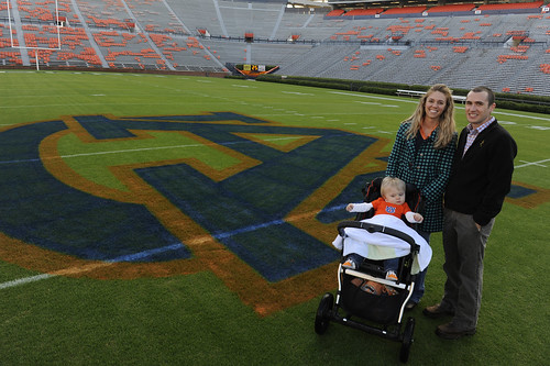 Sara and Michael Heatherly with their son Porter on the Auburn football field.