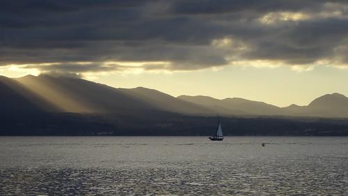 france guadeloupe sky cloudy sun ray sea boat holiday