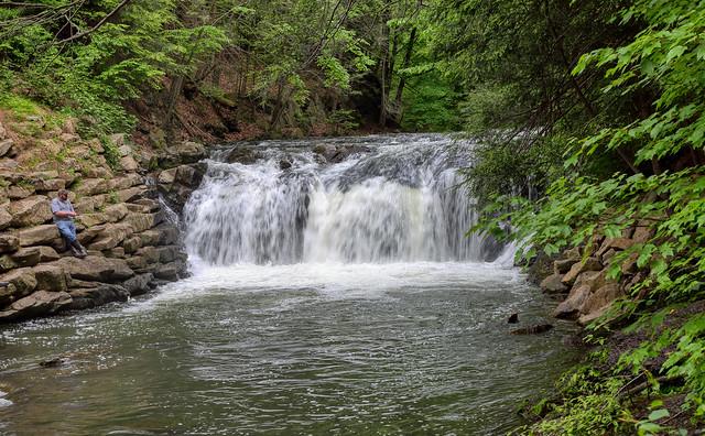 Fisherman and waterfall