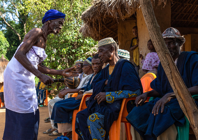 Senior Dan tribe woman begging for money to the chiefs during a ceremony, Bafing, Gboni, Ivory Coast