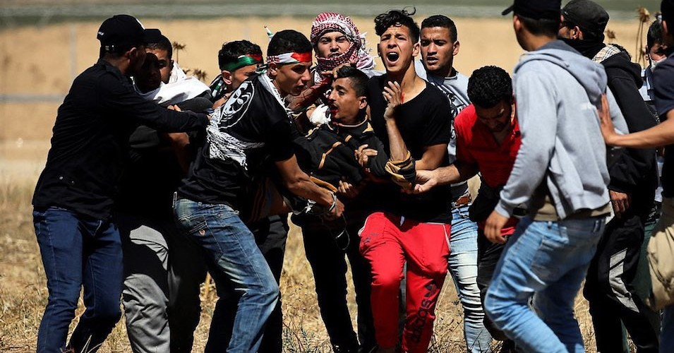 位於加薩走廊邊境的巴勒斯坦示威者。(圖片來源:Times of Gaza)