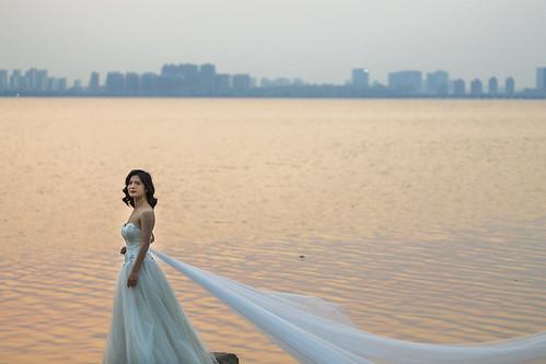 suzhou china lake water city wedding dress white sunset bride people candid
