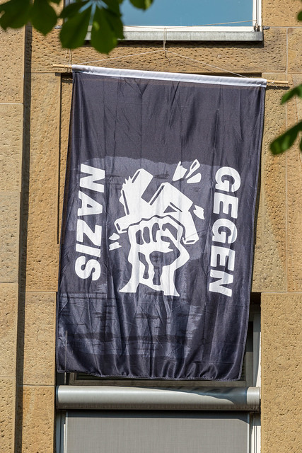 Flag hanging from a window shows protest against nazis