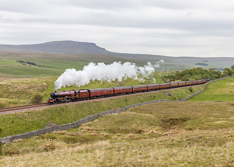 LMS Princess Royal Class 8P 6201 Princess Elizabeth returns to the Settle & Carlisle passing Selside with 1Z24 06:10 Norwich - Carlisle Pennine Limited which Lizzie took over at Hellifield.