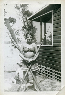 Vintage Photo of Woman in Swimsuit Posing with Oars