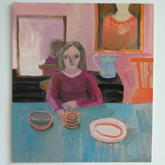 young woman at a table (blue cloth)