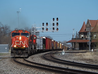 With the conductor waving, CN SD75I 5757 takes one west through booming Durand, Michigan coming across the CN Holly sub, on a nice spring afternoon.