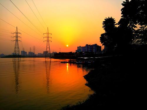outside light sunset bangladesh dhaka hatirjheel city sun landscape park lake waterboat warm explore