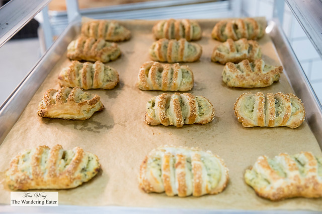 Sheet pan of fresh baked spinach and feta burekas