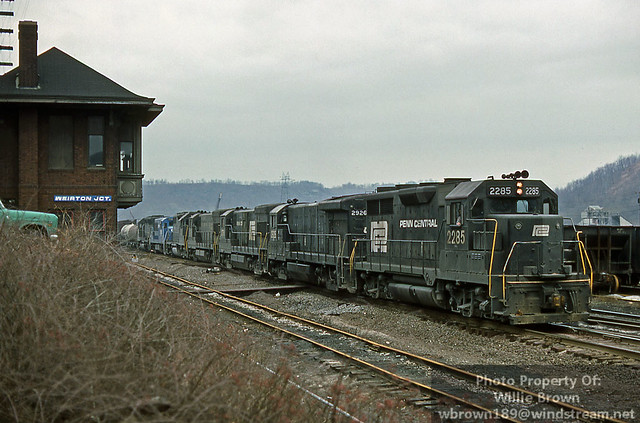 Conrail GP35 2285 leads a freight past Weirton Jct. Tower at Weirton, WV in March of 1977.