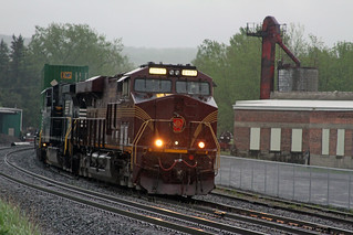 PRR heritage unit #8102 leads 205-25 West through Attica, NY on a stormy Spring evening.